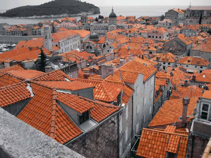 Artistic landscape of a collection of roofs in an old town.