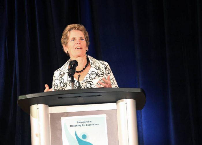 Portrait of Kathleen Wynne taken at a political event.