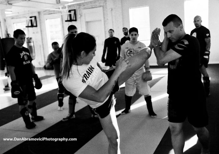 Artistic black and white photograph of a MMA fighter training.