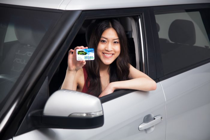Promotional photography of a young woman promoting a car share program.