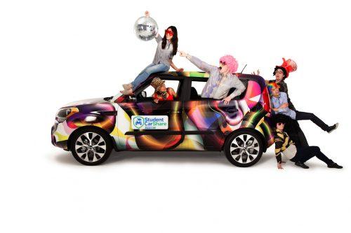 Artistic photograph of a group climbing on a a car.