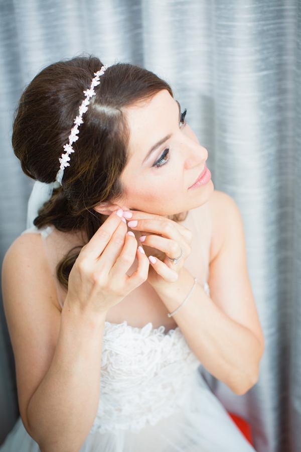 Wedding portrait of a beautiful bride getting ready.