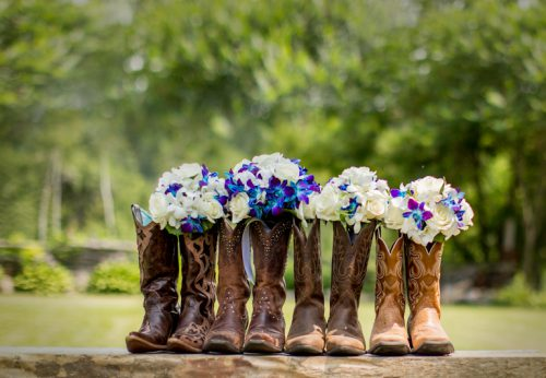 Artistic photography of a boots filled with flowers used as decoration for a wedding.