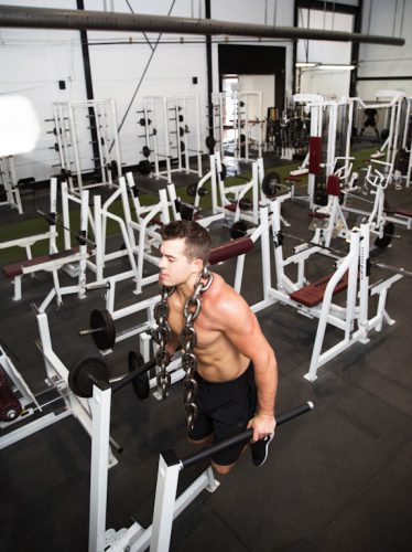 Professional portrait of a fitness trainer working in his gym.