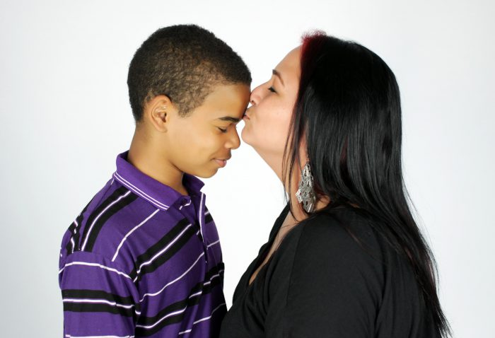 Beautiful portrait of a mother and her son on a white background.