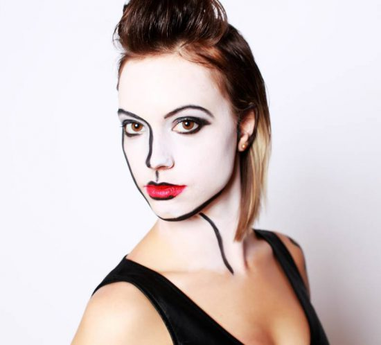 Professional portrait of a woman with beautiful hand drawn makeup.