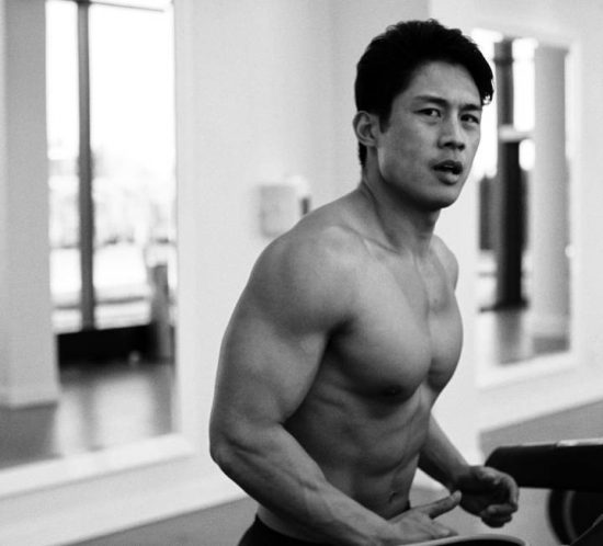Artistic black and white portrait of a fitness trainer in his gym.