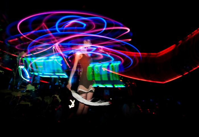 Artistic photograph showing swirling lights at a music event.