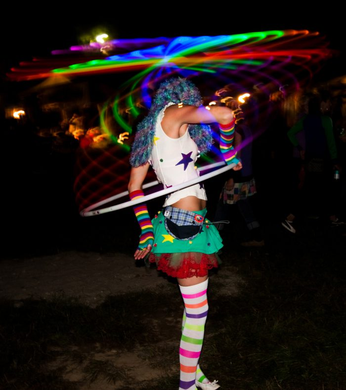 Artistic photograph of a woman partying at an outdoor event.