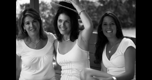 Artistic black and white portrait of a family of women.