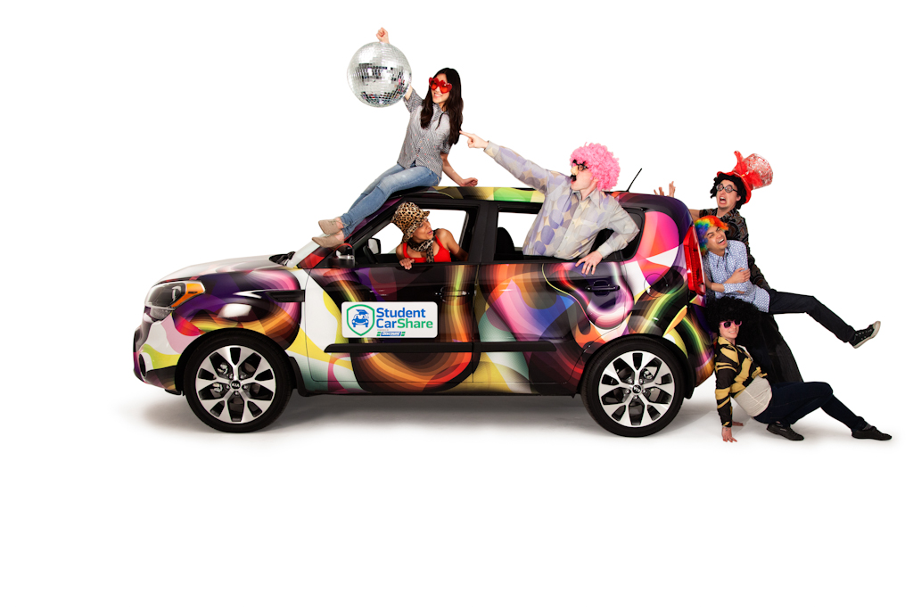 Artistic photograph of a group climbing on a a car.