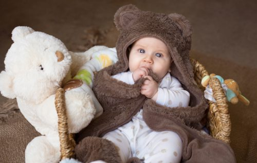 Professional portrait of a beautiful baby dressed as a bear.