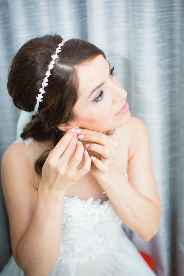 Wedding portrait of a beautiful bride getting ready.