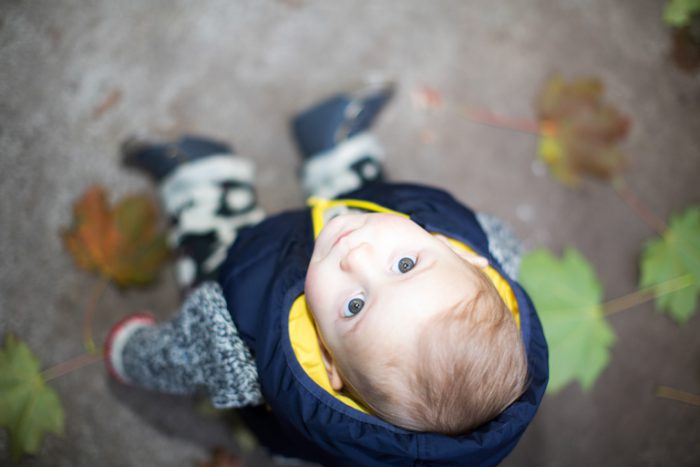 Artistic portrait of a young family member looking up at the camera.