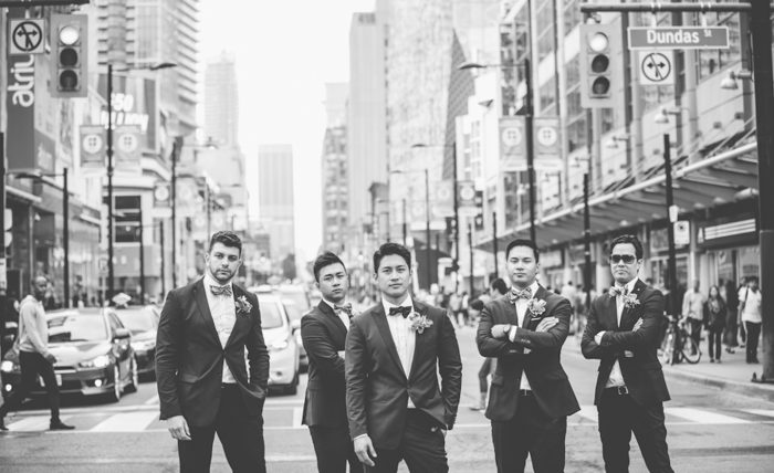 Artistic black and white portrait of a group of groomsmen on the streets of Toronto.