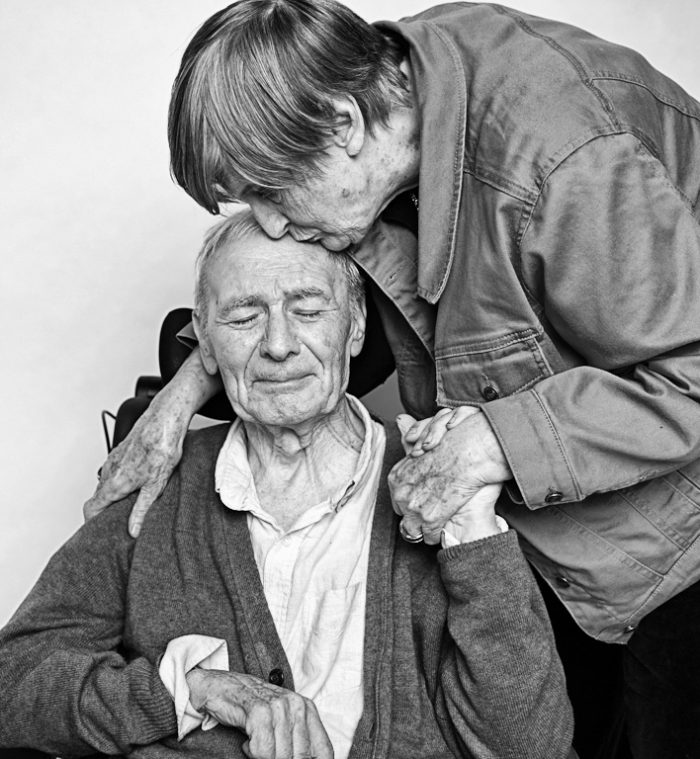 Artistic black and white portrait of an older man and woman together.