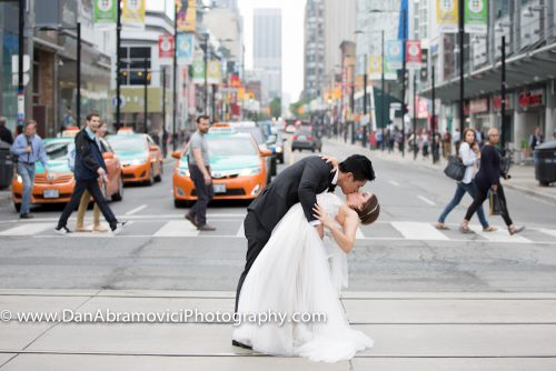 Artistic wedding photography of a couple kissing in downtown Toronto.