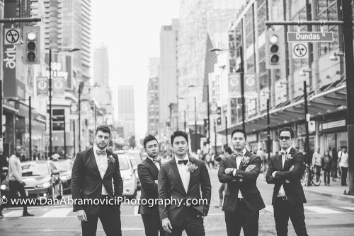 Professional black and white portrait of a groom and his groomsmen on the wedding day in the streets of Toronto.