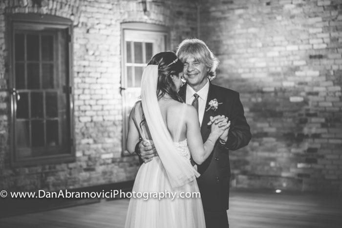 Artistic black and white wedding photograph of a father dancing with his beautiful daughter.