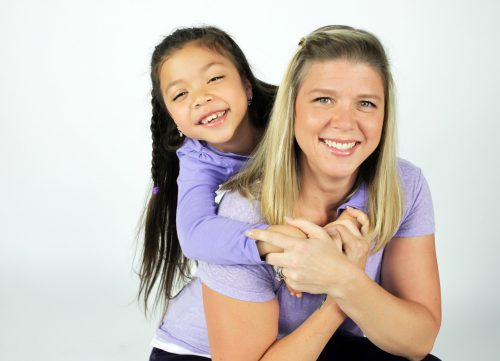 Affordable portrait of a mother and her daughter on a white background.