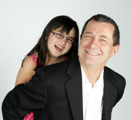Family portrait of a father and daughter on a white background.