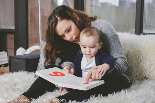 Family portrait of a mother and her child learning to read.