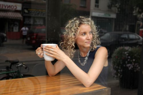 Beautiful portrait of a woman in a Toronto cafe for corporate profile.